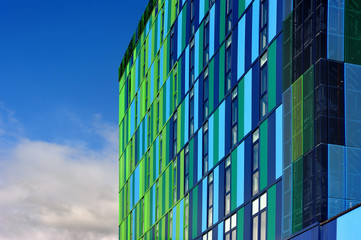 Glass colorful facade with cloudy sky