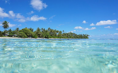 Tropical shore with turquoise water near Maeva village of Huahine island, seen from the ocean surface in the lagoon, Pacific, French Polynesia