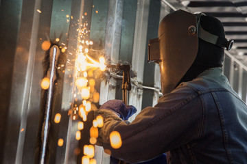 Worker and metal cutting with acetylene torch