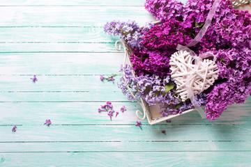 Fresh splendid lilac flowers on tray  and  white decorative hear