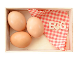 Isolate wooden box with eggs (clipping path)