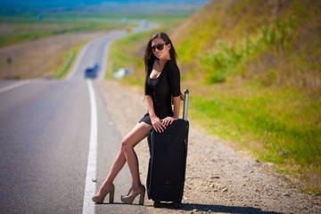 brunette woman road suitcase