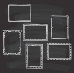 vintage photo frame in doodle style on chalkboard background