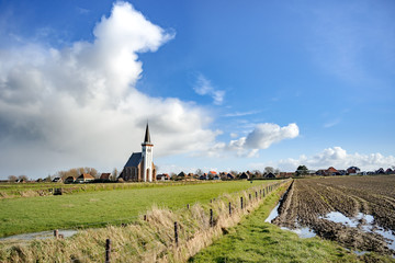 Typical white church in landscape at the island, Texel, Holland Wall mural