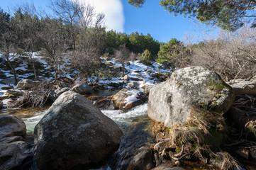The River Manzanares along its course through La Pedriza, in Guadarrama Mountains National Park, Madrid, Spain