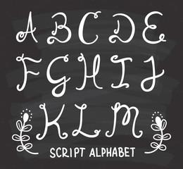 script alphabet on chalkboard background