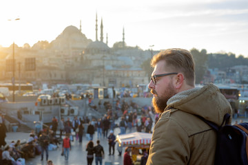 The young man looks at traveling Mosque in Istanbul