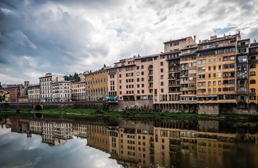 Buildings reflecting in Arno river in Florence,Italy.