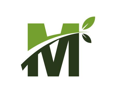 M green leaves letter swoosh ecology logo