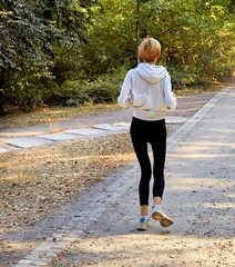 Anorexic woman running in park