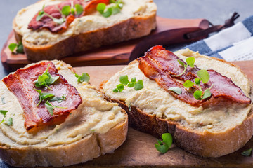 Spreads. Egg spread, grilled bacon, bread young basil leaves, Herb decoration. Ingredients: six eggs, spring onion, yeast, processed cheese, bacon, salt, pepper, various herbs decorations.