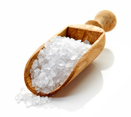 Granulated sea salt on white background