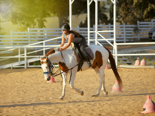 young girl is riding a horse