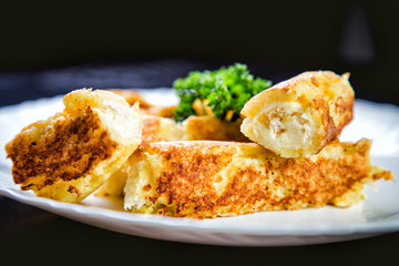 Rolls of cheese and bread, a dish in cafe