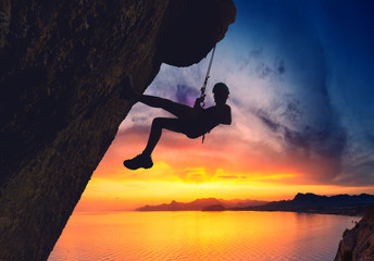 Rock climber against sunset