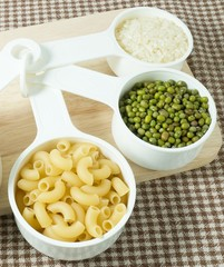 Pasta, Rice and Mung Beans in Measuring Spoons