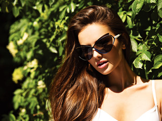 young beautiful woman with long hairs in black sunglasses.