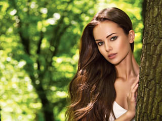 portrait of the young beautiful woman with long hairs. outdoors