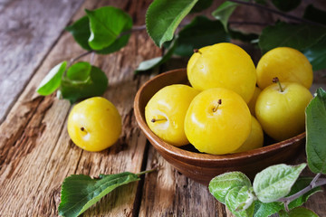 Ripe yellow plums