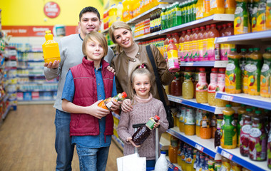 Parents with two kids choosing soda