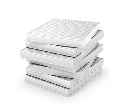 stack of white mattresses