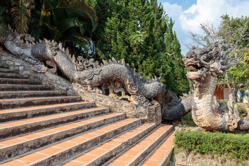 The dragon guarding the entrance to the pagoda Linh An. Pagoda is located in Nam Ban hamlet around 30km southwest of Dalat, Vietnam.