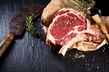 Beef cote de boeuf ribs slice and butcher knife