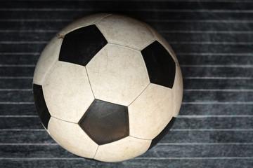 Football on a black floor