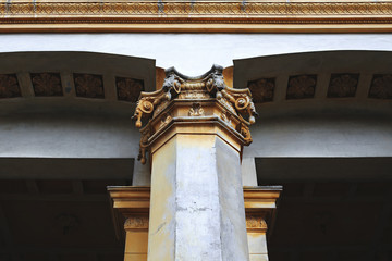 Classical old column. Stalinist architecture is classic, a fragment of the facade.