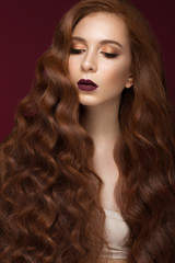 Beautiful Redhead girl with a perfectly curls hair and classic make-up. Beauty face.