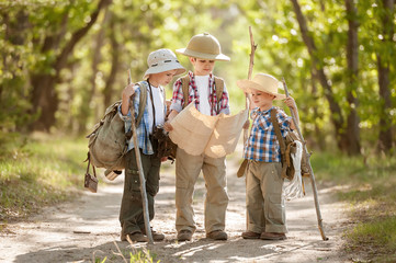 Boys travelers exploring route map