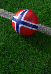 Soccer ball and national flag of Norway,  green grass