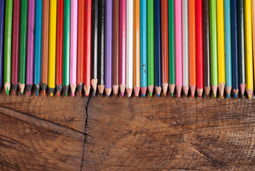 colored pencils on wooden table