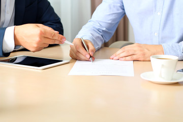 two colleagues is signing a contract, business meeting in the of
