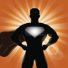 Superhero standing with hands on hips silhouette. Superhero chest for your company name and logo.