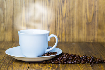 Cup of the offee on the old brown wood background