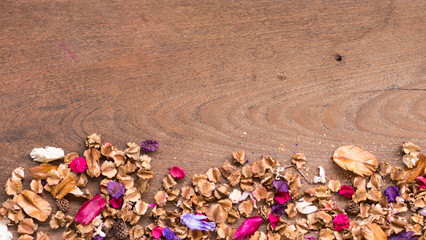 Top view workspace with dried flowers on wooden table background