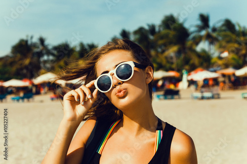 b5d24c0d549 Summer lifestyle happy smiling portrait of pretty young woman blonde  fashion having fun on the beach on tropic island in sunglasses
