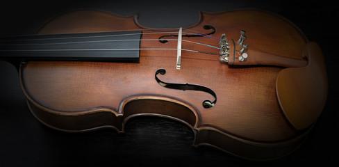 Detail of violin on dark background