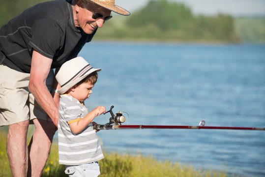 Grandfather having great time with his grandson, fishing