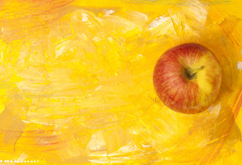 Red and yellow apple on golden artistic background with copyspace
