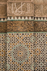 tile work and carved calligraphy in the 14th century Bou Inania medrese in Fes