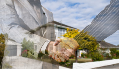 double exposure of handshake over the house - business trading concept