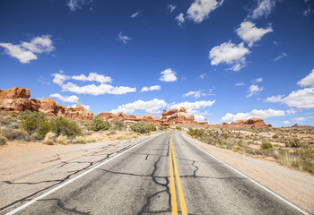 Scenic road with blue sky, Arches National Park, USA