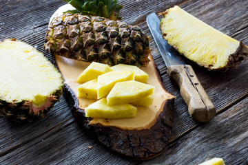 Pineapple fruit cut on wooden background