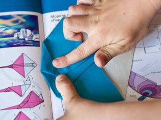 Fold a paper airplane