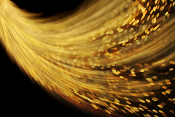Abstract gold dust trail wave background