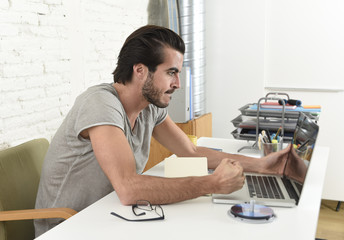modern hipster style student or businessman working in stress with laptop at home office angry upset