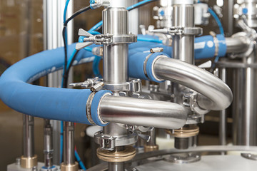 Dairy production. Apparatus for bottling milk products
