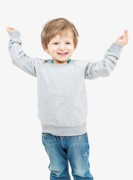 Cute blonde small boy dressed in a gray sweater with no image. Empty space template you can place your print. Mockups